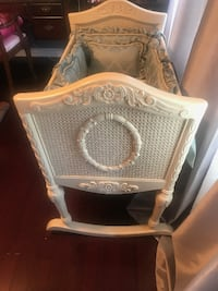 Antique Rocking Crib with Tapestry Bedding