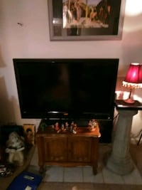 flat screen TV and brown wooden TV stand Omaha, 68138