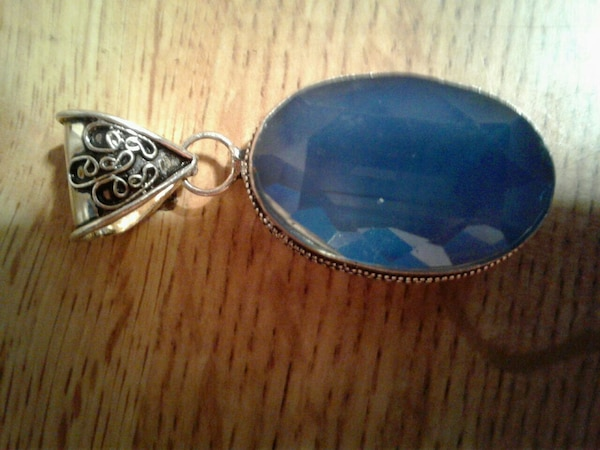 , sterling silver pendant with a beautiful blue st