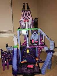 Purple and pink plastic dollhouse