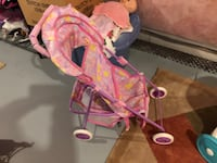 baby's pink and white cradle and swing