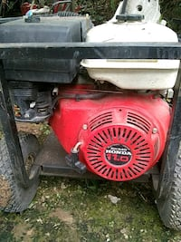 red and black Honda portable generator Dalton, 30721