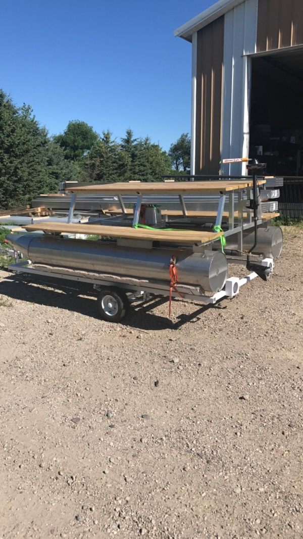 Pontoon picnic table  Deep cycle interstate battery  Trolling motor and  trailer  Also includes corona umbrella  Pontoons are stainless steel