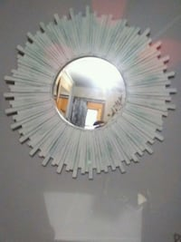 round white and brown wooden framed mirror 3490 km