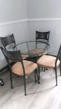 round glass top table with four chairs dining set Pawtucket, 02860