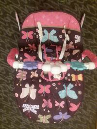 Baby's black and pink butterfly bouncer