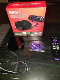 Roku 3 TV box with remote and purple canalbuds