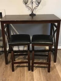 Table and leather stools