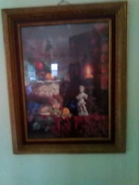 painting of people with brown wooden frame Stockton, 95207