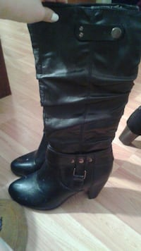 2 pairs of knee high boots.
