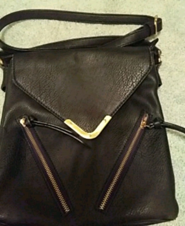 e878faf992bd Used black and brown leather crossbody bag for sale in Carrollton ...