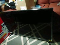 black flat screen TV with remote Bluffton, 29910