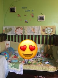 baby's green and white crib mobile