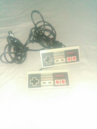 two NES game controllers