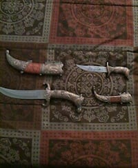two gray handled knives with sheaths Bronx, 10456