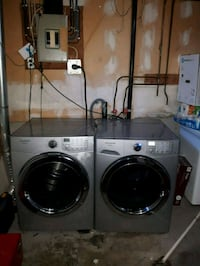 two white front-load clothes washer and dryer set 3148 km
