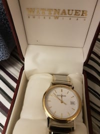 round white and gold-colored Wittnauer analog watch with link bracelet