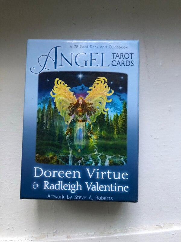 Angel tarot cards with book d82e6159-6c41-4aa1-8a87-daf57100f9ea