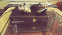 Xbox 360 with 8 games Conley