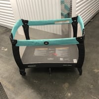 baby's teal and black travel cot WASHINGTON