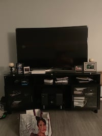 flat screen television with black wooden TV stand Houston, 77088