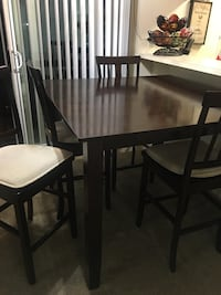 Rectangular black wooden table with four chairs dining set Chula Vista, 91910