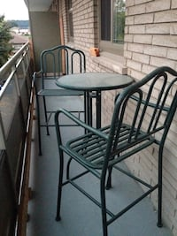round black metal table with four chairs patio set Hamilton