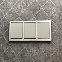 Silver 3 photo picture frame. Holds 5in x 7 in photos.