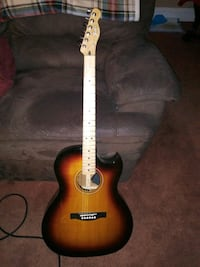 brown and black acoustic guitar Queens, 11414