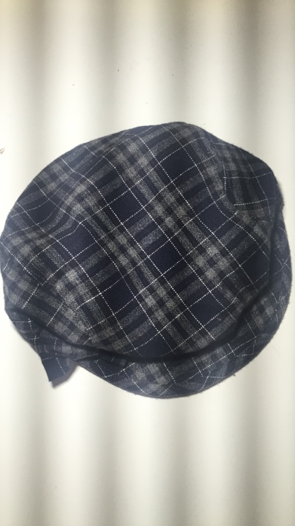 gray and black plaid hat