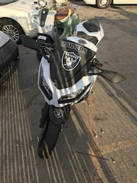 Black and white oakland raiders sports motorcycl