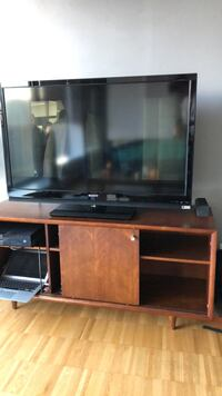 black flat screen TV with brown wooden TV stand Vancouver, V6B 1H4