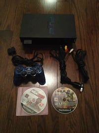 black Sony PS3 slim console with controller and game cases Toronto, M1V 5P7
