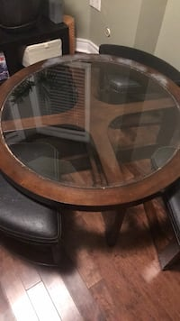 round brown wooden framed glass top coffee table Toronto, M8Z 3A3