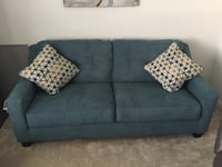 Teal sofa with two throw pillows. I have had it less than a year and it is still in new condition. Hardly ever used   San Antonio, 78230