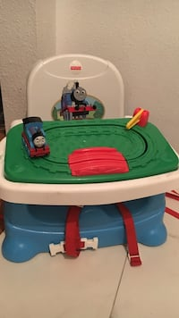 Green, white, and blue Fisher Price Thomas And Friends feeding chair
