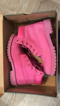 pair of pink Timberland work boots with box