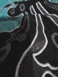 black, gray, and white floral textile
