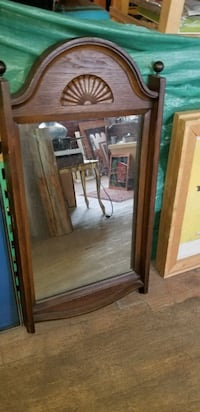 brown wooden framed wall mirror 791 km