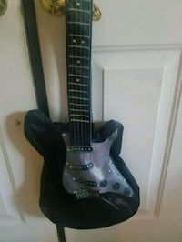 black and brown electric guitar Murrieta