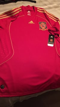 red and yellow Adidas crew-neck jersey shirt