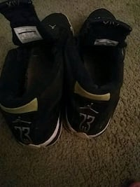 pair of black-and-white Air Jordan shoes Independence, 64050