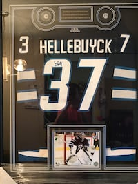 Connor Hellebuyck signed jersey Framed With game Jets Pucks Winnipeg, R2C 5A1