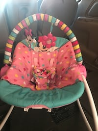 baby's pink and teal Disney Minnie Mouse bouncer Frankfort, 46041