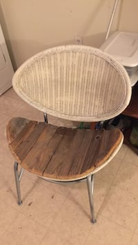 Wicker and wood re Purposed chair. Very comfortable.if u favorite it I will never know how to contact u.