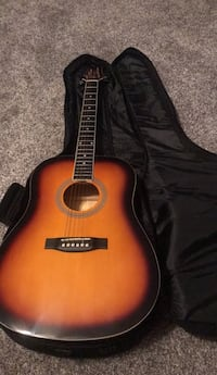 brown and black acoustic guitar Elm Grove, 71051