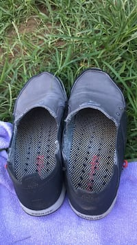 pair of black slip-on shoes Vienna, 22182