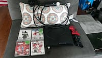 black sony ps3 game console with 4 game cases Mississauga, L5J 3Z2