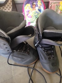 pair of grey leather sports boots