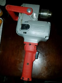 white and red cordless power drill